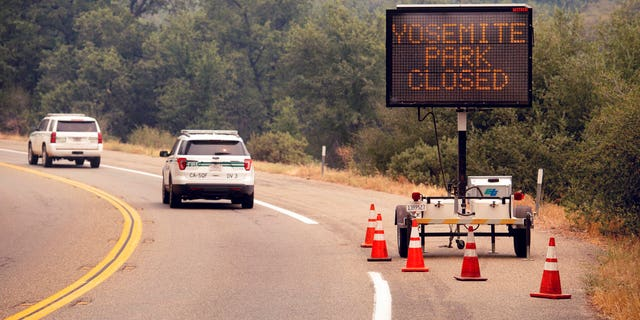 A sign on Highway 41 announces the closure of Yosemite National Park near Oakhurst, Calif., on Wednesday, July 25, 2018. Parts of the park closed Wednesday as firefighters work to contain the Ferguson fire burning nearby.