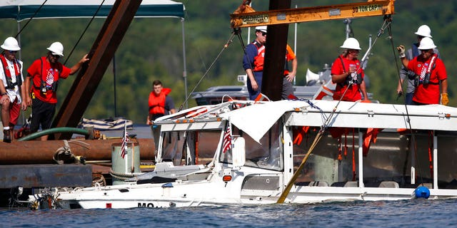 The duck boat that sank in Table Rock Lake in Branson, Mo., was raised four days after the tragedy.