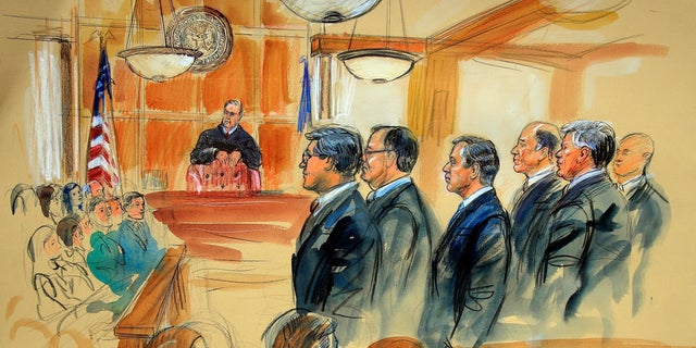 This courtroom sketch depicts Paul Manafort, fourth from right, standing with his lawyers in front of U.S. district Judge T.S. Ellis III, center rear, and the selected jury, seated left.