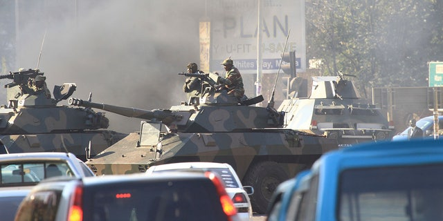 Military tanks patrol the streets in Harare, Zimbabwe.