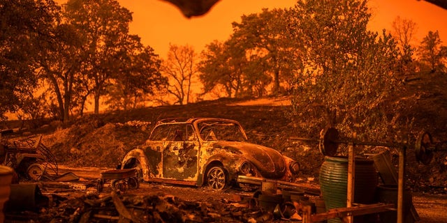 A Volkswagen Beetle scorched by a wildfire called the Carr Fire rests at a residence in Redding.