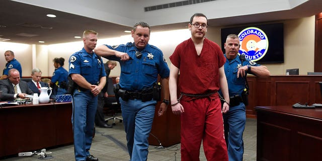 In this Aug. 26, 2015, file photo, Colorado theater shooter James Holmes, right, is led out of the courtroom after being formally sentenced in Centennial, Colo., to serve life in prison without parole.