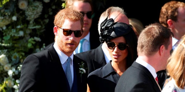 Meghan Markle and Prince Harry at a friend's wedding amid the Duchess of Sussex' family drama.
