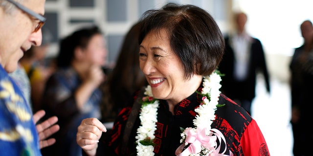 U.S. Rep. Colleen Hanabusa, D-Hawaii, who is giving up her seat in Congress to run for Hawaii governor, talks with a guest at an event in Honolulu,  April 28, 2018.