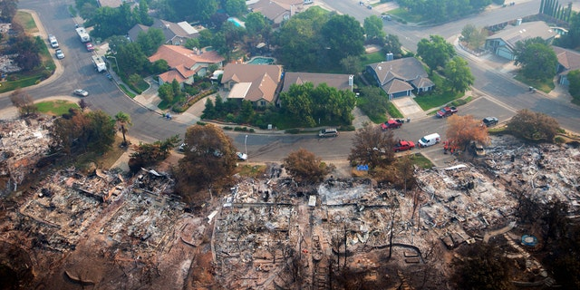 Homes destroyed by a wildfire are seen from an aerial view in the Keswick neighborhood of Redding, Calif., Friday, Aug. 10, 2018.