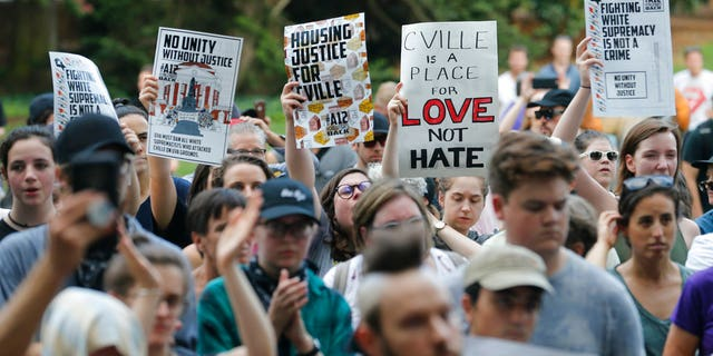 Demonstrators march on the campus of the University of Virginia in anticipation of the anniversary of last year's Unite the Right rally in Charlottesville.