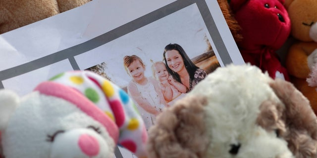 A photograph of Shanann Watts and her daughters, Bella, 4, left, and Celeste, 3, is shown at a makeshift memorial in Frederick, Colorado on Thursday.