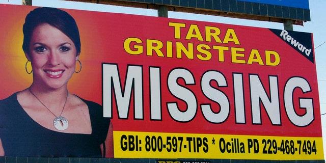 A photo of missing teacher Tara Grinstead is seen on a billboard in Ocilla, Georgia, in 2006.
