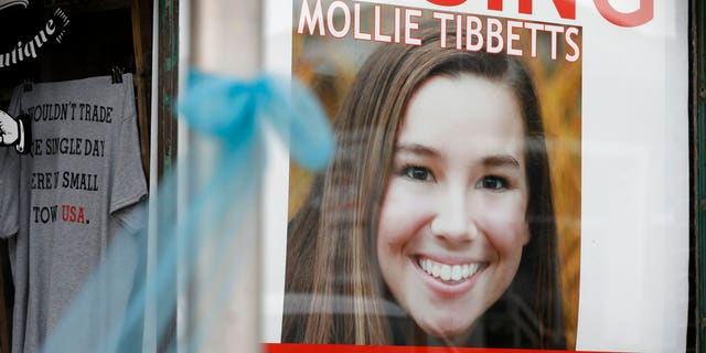 A poster for missing University of Iowa student Mollie Tibbetts hung in the window of a local business on Tuesday in Brooklyn, Iowa.