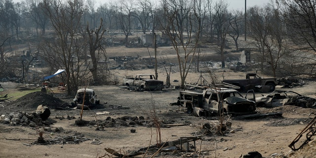 Burned out cars sit in a neighborhood burned in the Carr Fire in Redding, Calif., Aug. 11, 2018.