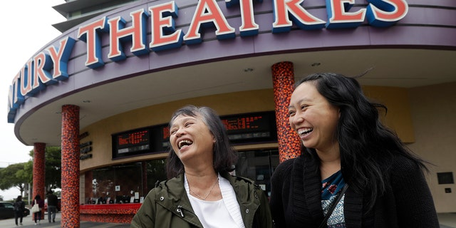 """Alice Sue, left, and her daughter Audrey Sue-Matsumoto laugh while interviewed after watching the movie """"Crazy Rich Asians"""" in Daly City, Calif., Aug. 23, 2018."""