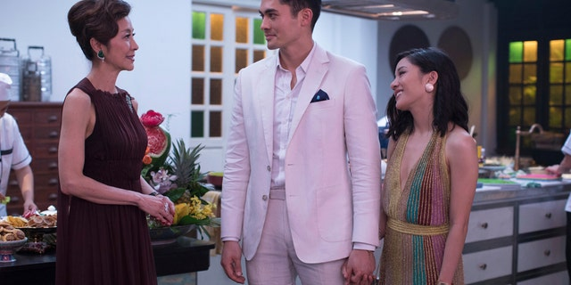 "Michelle Yeoh, from left, Henry Golding and Constance Wu in a scene from the film ""Crazy Rich Asians."" When ""Crazy Rich Asians"" surpassed expectations and grabbed the top spot in its opening weekend."