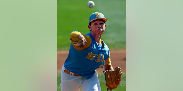 Honolulu, Hawaii's Aukai Kea delivers in the first inning of the United States Championship baseball game against Peachtree City, Georgia at the Little League World Series tournament in South Williamsport, Pa., Saturday, Aug. 25, 2018.