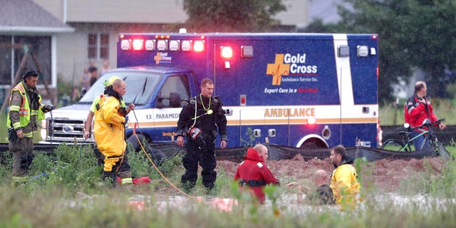 The boy was rescued when a firefighter spotted the child's finger poking out of the manhole.