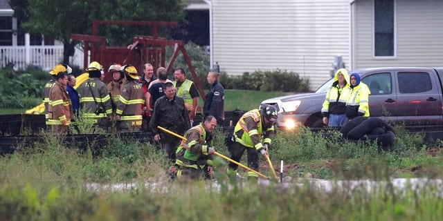 A boy sucked into the flooded Wisconsin storm sewer was saved when an eagle-eyed firefighter saw the boy's fingers pop through an opening in a manhole cover.