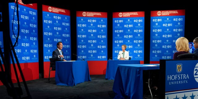 New York Gov. Andrew Cuomo and Democratic New York gubernatorial candidate Cynthia Nixon engage during a gubernatorial debate at Hofstra University in Hempstead, N.Y., Wednesday, Aug. 29, 2018.