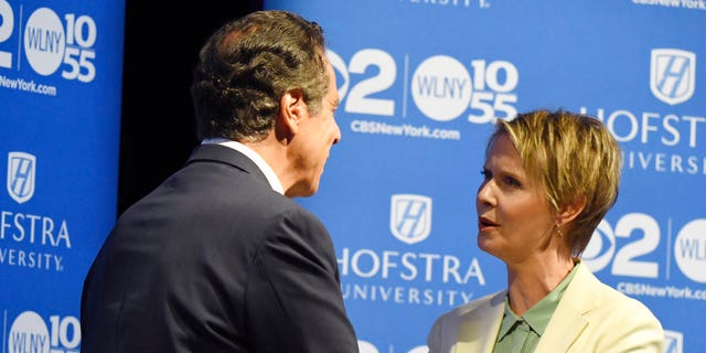 New York Gov. Andrew M. Cuomo and Cynthia Nixon shake hands at Hofstra University in Hempstead on Wednesday, Aug. 29, 2018 ahead of their the Democratic gubernatorial primary debate.