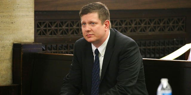 In this May 4, 2018 file photo, Chicago police Officer Jason Van Dyke attends a hearing for the shooting death of Laquan McDonald at the Leighton Criminal Court Building, in Chicago
