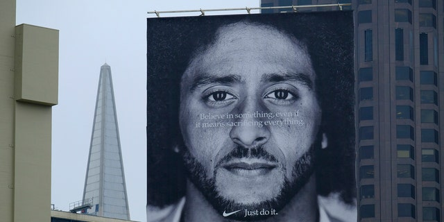 A large billboard stands on top of a Nike store showing former San Francisco 49ers quarterback Colin Kaepernick at Union Square, Wednesday, Sept. 5, 2018, in San Francisco.