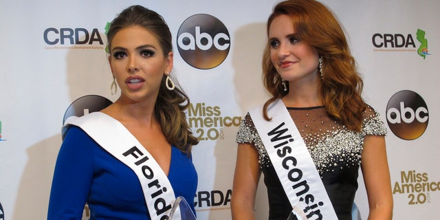 Miss Florida, Taylor Tyson, left, and Miss Wisconsin, Tianna Vanderhei, talk to the media after the first night of preliminary competition at the Miss America competition in Atlantic City, N.J., Wednesday, Sept. 5, 2018.