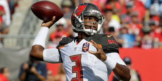 Tampa Bay Buccaneers quarterback Jameis Winston (3) looks to throw the ball during the first half of an NFL football game against the Tennessee Titans in Tampa, Fla., Sept. 13, 2015.