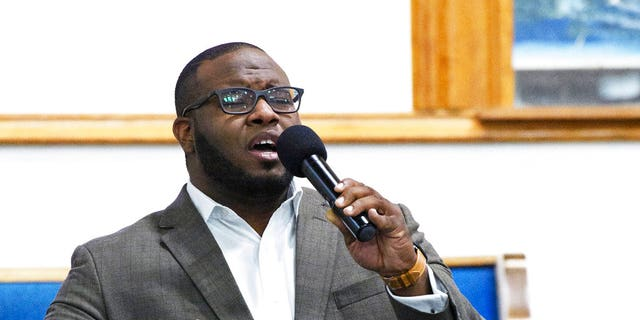 Botham Jean leads a Harding University event in Dallas, Sept. 21, 2017.