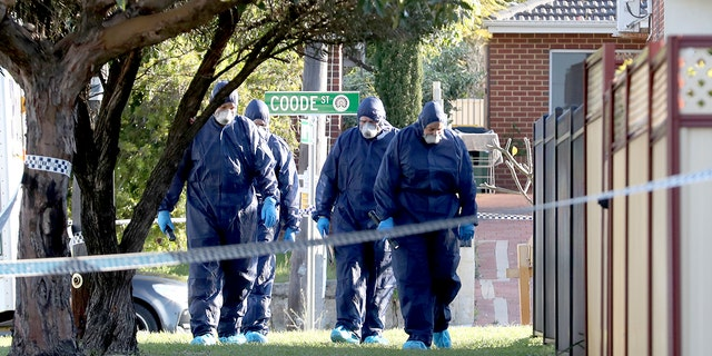 Forensic police officers inspect a property in suburban Perth, Australia.