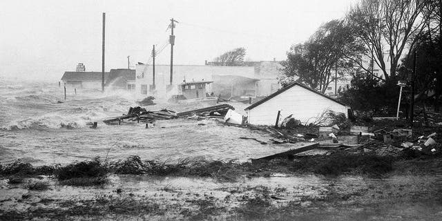 In this Oct. 15, 1954 file photo, high tides, whipped in by Hurricane Hazel, shatter boats and buildings in Swansboro, N.C., as the storm lashes the Atlantic seaboard.