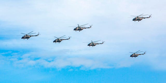 Russian military helicopters fly, in the Chita region, Eastern Siberia; Russia's military chief of staff says that the military exercises expected to be the biggest in three decades, will involve nearly 300,000 troops
