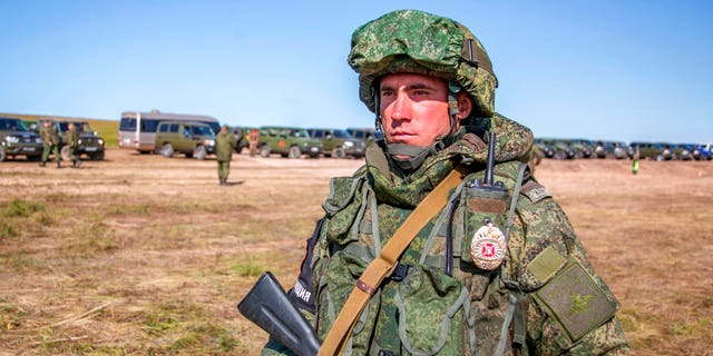 A Russian soldier guards an area during the military exercises