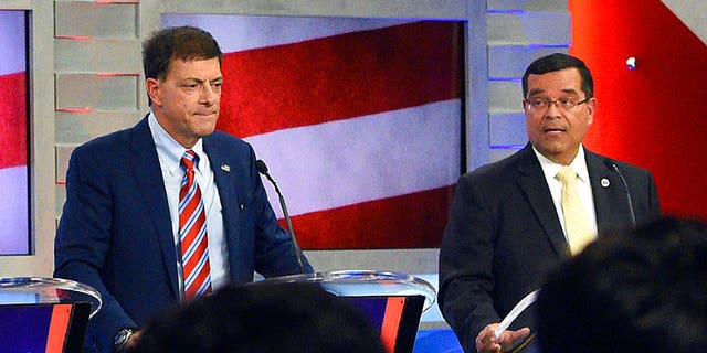In this Sept. 7, 2018 file photo, New Hampshire Republicans Stewart Levenson, left, and state Rep. Steve Negron participate in the 2nd Congressional District debate at Saint Anselm College in Manchester, N.H.