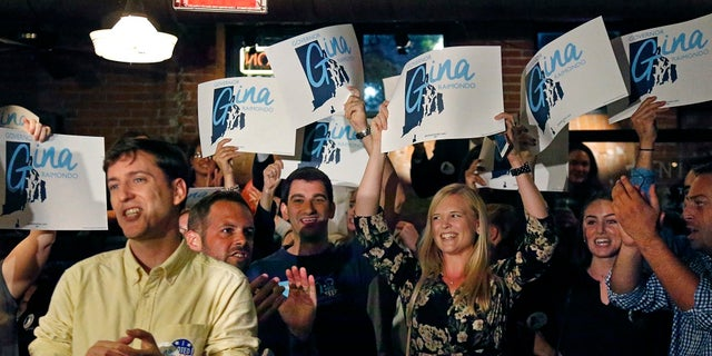 Supporters of incumbent Democratic Rhode Island Gov. Gina Raimondo cheer as they watch results on TV at her primary night party.