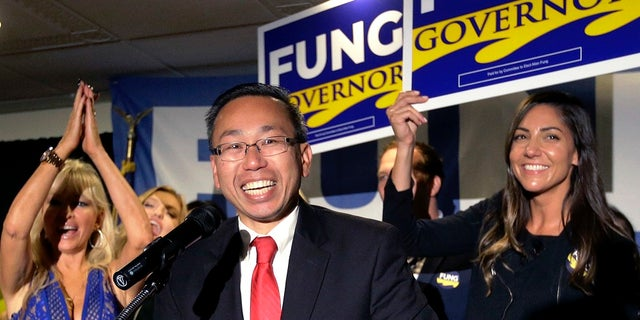 FILE: Cranston, R.I., Mayor Allan Fung, center, celebrates victory over R.I. House Minority Leader Patricia Morgan in the Republican gubernatorial primary.