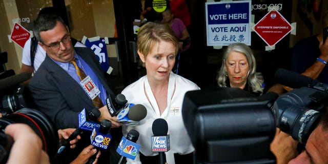 FILE: New York gubernatorial candidate Cynthia Nixon, center, speaks to members of the media outside a polling station after voting in the primary.