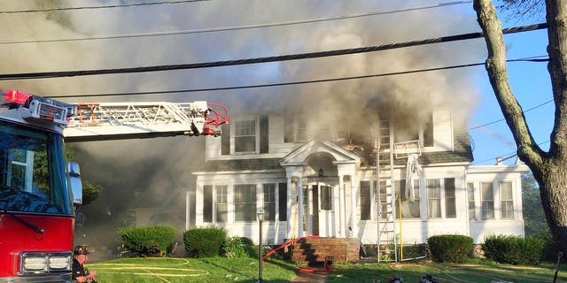 Firefighters battle a house fire in North Andover, Massachusetts, on Thursday as one of multiple emergency crews responding to a series of gas explosions and fires triggered by a problem with a gas line that feeds homes in several communities north of Boston.