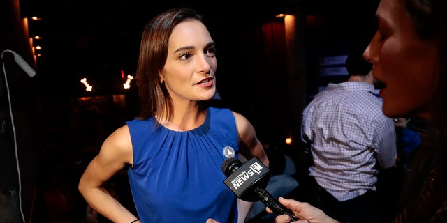 Julia Salazar, left, answers questions during an interview after winning the Democratic primary over Martin Dilan in New York's 18th State Senate district race.