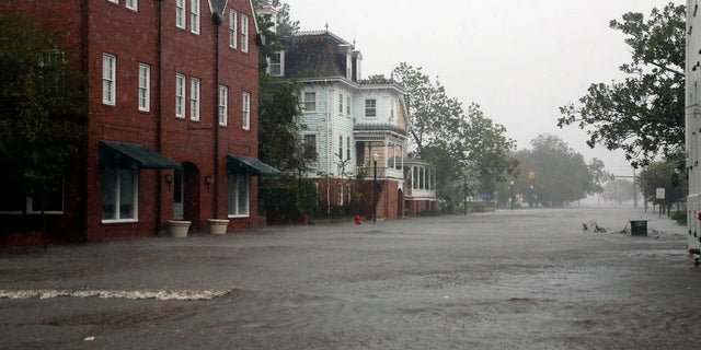 Flooding caused by Hurricane Florence covers blocks of Front Street in downtown New Bern, North Carolina.