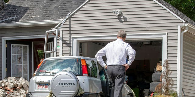 Massachusetts Gov. Charlie Baker tours the site where an 18-year-old man was killed during a gas explosion in Lawrence, Mass., Sept. 14, 2018.