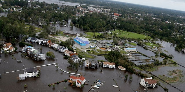 Homes and a marina are flooded as a result of high tides and rain from hurricane Florence which moved through the area in Jacksonville, N.C.