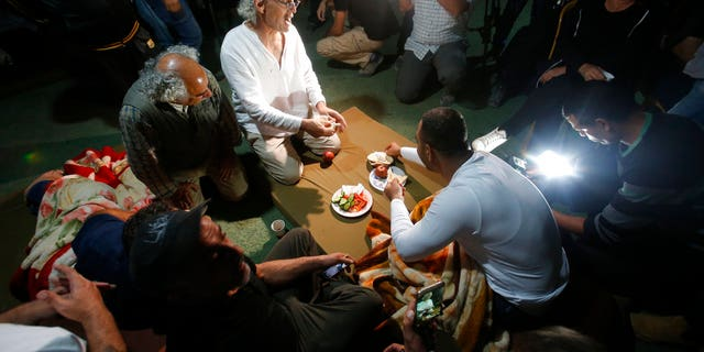 FILE: Frank Roimano is eating breakfast in the West Bank community of Khan al-Ahmar after being released from Israeli police custody.