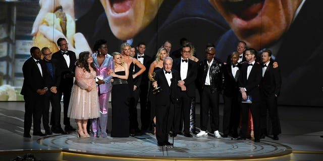 "Lorne Michaels, center, and the cast and crew from ""Saturday Night Live"" accept the award for outstanding variety sketch series at the 70th Primetime Emmy Awards on Monday."