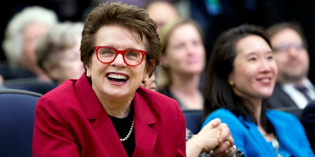 Tennis great Billie Jean King, left, laughs during an event at the Eisenhower Executive Office Building on the White House complex in Washington, Jan. 29, 2016.