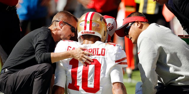 FILE: Trainers attend to San Francisco 49ers quarterback Jimmy Garoppolo (10) who was injured after a tackle by Kansas City Chiefs defensive back during the second half of a game in Kansas City, MO.