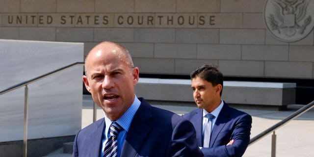 File: Michael Avenatti, the attorney for porn actress Stormy Daniels replies to questions by reporters during a news conference in front of the U.S. Federal Courthouse in Los Angeles.