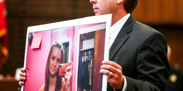 Deputy Prosecutor Jay Hale holds up a picture of Jessica Chambers on the first day of the retrial of Quinton Tellis in Batesville, Miss.