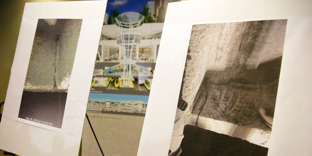 Photographs showing a cracked steel beam found in the Salesforce Transit Center are displayed during a news conference.
