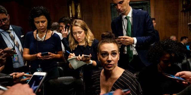 Alyssa Milano said she was at the hearing in support of Christine Blasey Ford and was invited as a guest of Sen. Dianne Feinstein.  (AP)