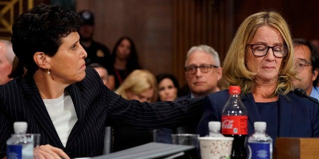 Attorney Debra Katz puts her hand on Christine Blasey Ford as she testifies before the Senate Judiciary Committee.