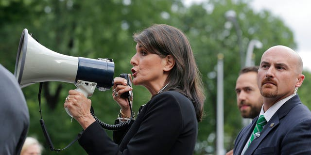 Nikki Haley greeted Venezuelan protesters outside the United Nations demonstrating against the country's authoritarian President Nicolas Maduro