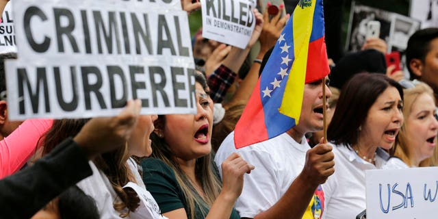 Protesters attends a rally against Venezuelan President Nicolas Maduro outside United Nations headquarters in New York